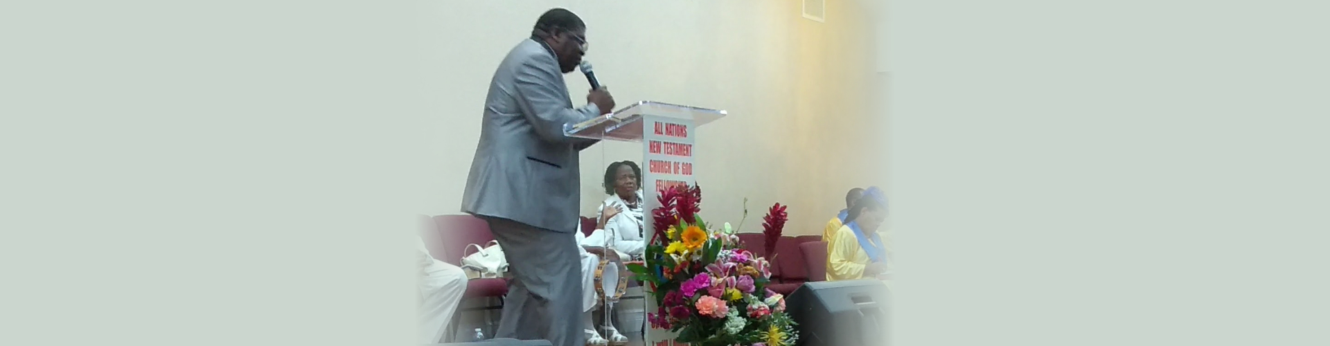 Pastor preaching on stage