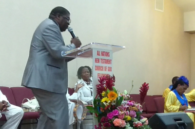 Pastor preaching at stage